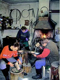 Stanislav Otruba with his sons in the workshop