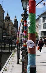 Knitted graffiti on a street lamp